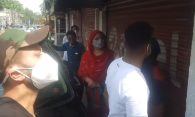 A woman and her daughter clash with the owner of a liquor shop